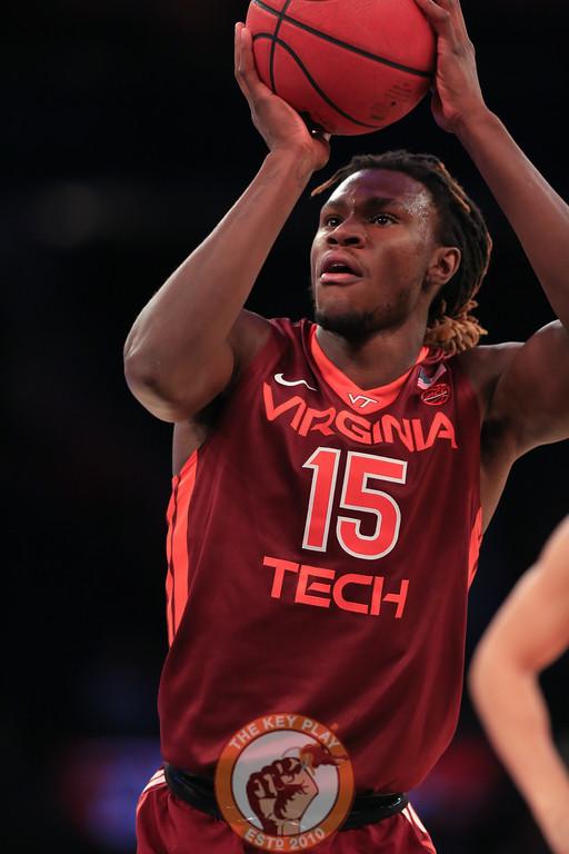 Virginia Tech's forward Chris Clarke (15) takes a shot during play against Washington in Madison Square Garden, Nov. 17, 2017. Virginia Tech won the game 103-79.