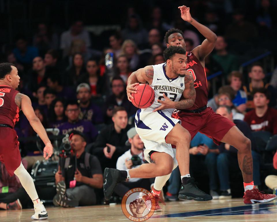 Washington's guard Carlos Johnson (23) drives against Virginia Tech's guard Justin Bibbs (10) in Madison Square Garden, Nov. 17, 2017. Virginia Tech won the game 103-79.
