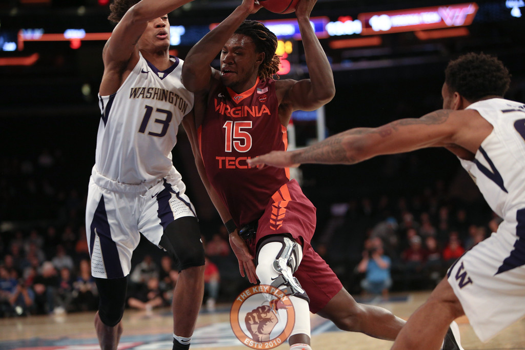 Virginia Tech's forward Chris Clarke (15) drives past Washington's forward Hameir Wright (13) in Madison Square Garden, Nov. 17, 2017. Virginia Tech won the game 103-79.