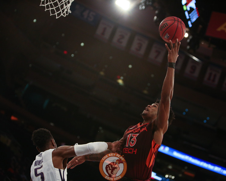 Virginia Tech's guard Ahmed Hill (13) shoots over Washington's guard Jaylen Nowell (5) in Madison Square Garden, Nov. 17, 2017. Virginia Tech won the game 103-79.