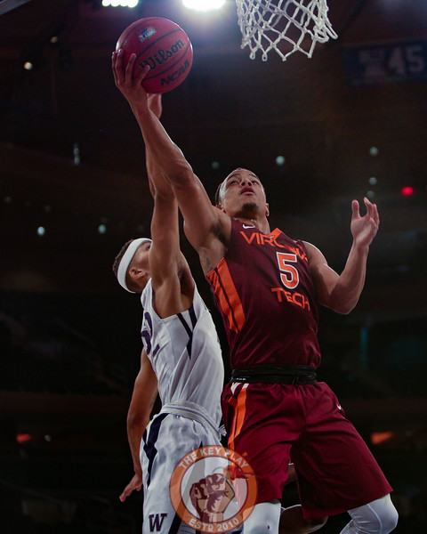 Virginia Tech's guard Justin Robinson (5) shoots a layup past Washington's forward Dominic Green (22) in Madison Square Garden, Nov. 17, 2017. Virginia Tech won the game 103-79.