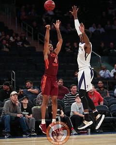 Virginia Tech's guard Nickeil Alexander-Walker (4) shoots over a Washington defender in Madison Square Garden, Nov. 17, 2017. Virginia Tech won the game 103-79.