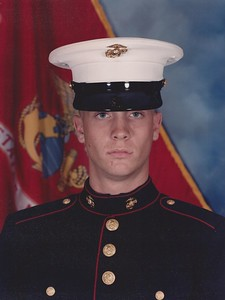 "Bryan Mitchell, U.S. Marine Corps lance corporal, husband to Ana Mitchell, who says: ""Thanks for serving our country and extending your dedication to your family, friends and community. We love you!"""