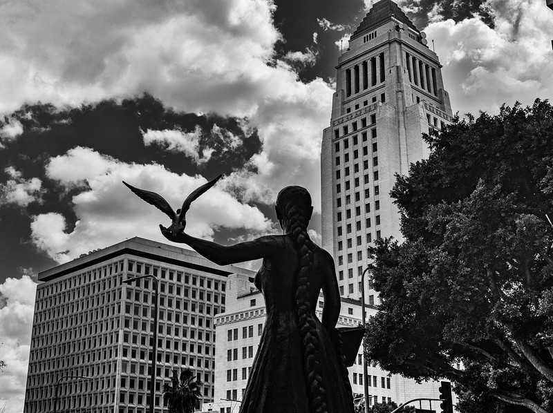 Alison Star sculpture stands guard at Hall of Justice, watching City Hall