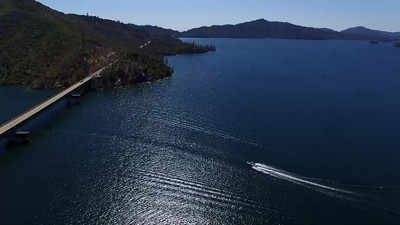 Whiskeytown bay and bridge-the speed boat returns