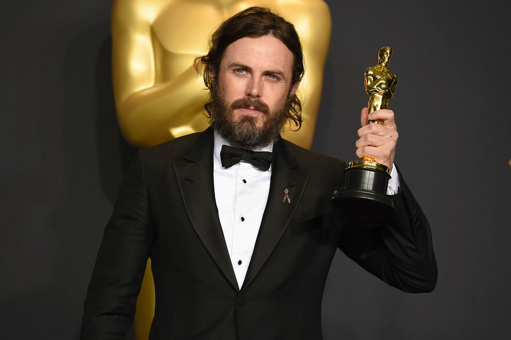 """. Casey Affleck poses in the press room with the award for best actor in a leading role for \""""Manchester by the Sea\"""" at the Oscars on Sunday, Feb. 26, 2017, at the Dolby Theatre in Los Angeles. (Photo by Jordan Strauss/Invision/AP)"""
