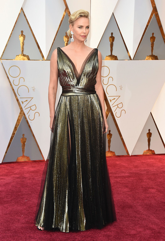 . Charlize Theron arrives at the Oscars on Sunday, Feb. 26, 2017, at the Dolby Theatre in Los Angeles. (Photo by Jordan Strauss/Invision/AP)
