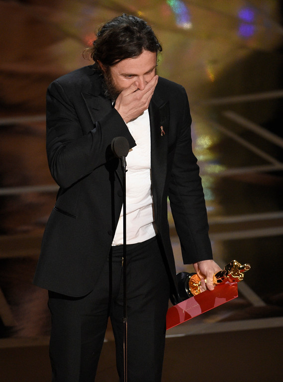 """. Casey Affleck reacts as he walks on stage to accept the award for best actor in a leading role for \""""Manchester by the Sea\"""" at the Oscars on Sunday, Feb. 26, 2017, at the Dolby Theatre in Los Angeles. (Photo by Chris Pizzello/Invision/AP)"""
