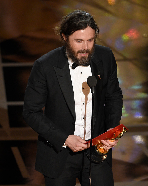 """. Casey Affleck accepts the award for best actor in a leading role for \""""Manchester by the Sea\"""" at the Oscars on Sunday, Feb. 26, 2017, at the Dolby Theatre in Los Angeles. (Photo by Chris Pizzello/Invision/AP)"""
