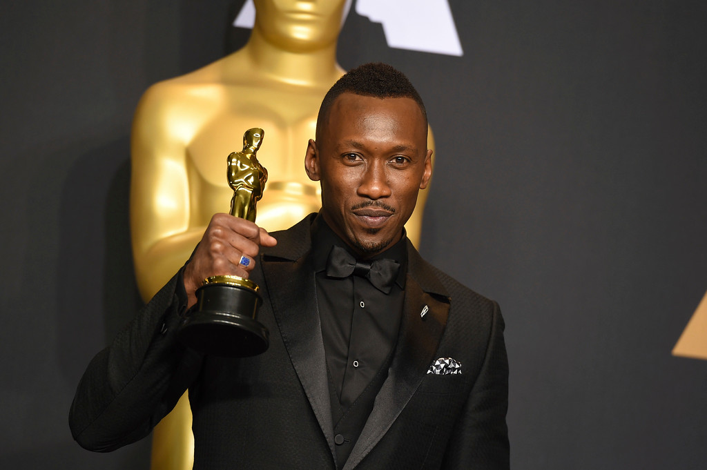 """. Mahershala Ali poses in the press room with the award for best actor in a supporting role for \""""Moonlight\"""" at the Oscars on Sunday, Feb. 26, 2017, at the Dolby Theatre in Los Angeles. (Photo by Jordan Strauss/Invision/AP)"""