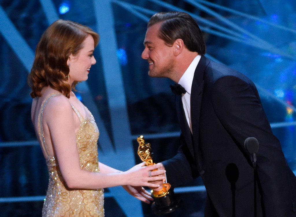 """. Leonardo DiCaprio, right, presents Emma Stone with the award for best actress in a leading role for \""""La La Land\"""" at the Oscars on Sunday, Feb. 26, 2017, at the Dolby Theatre in Los Angeles. (Photo by Chris Pizzello/Invision/AP)"""