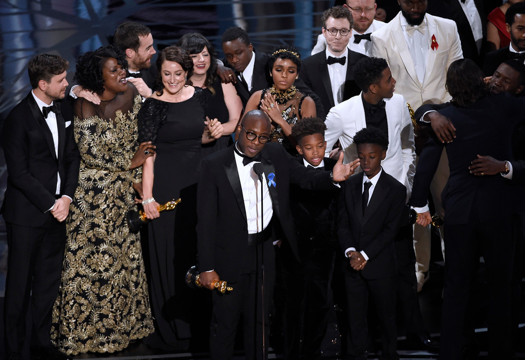 """. Barry Jenkins, foreground center, and the cast accept the award for best picture for \""""Moonlight\"""" at the Oscars on Sunday, Feb. 26, 2017, at the Dolby Theatre in Los Angeles. (Photo by Chris Pizzello/Invision/AP)"""