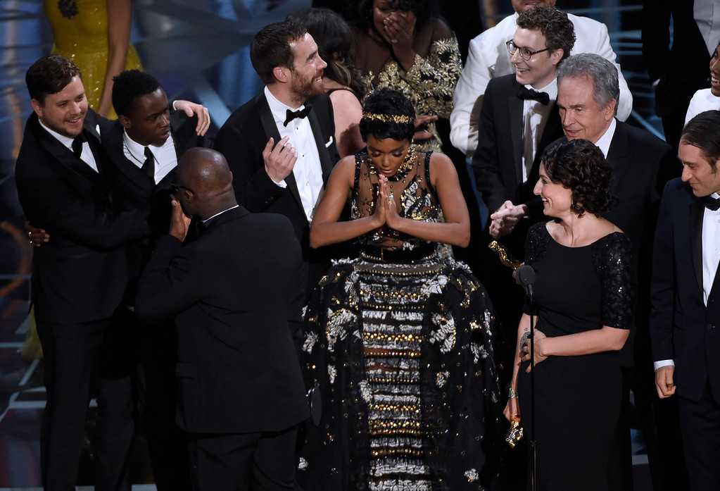 """. Janelle Monae, center, reacts as \""""Moonlight\"""" is announced as the winner of best picture at the Oscars on Sunday, Feb. 26, 2017, at the Dolby Theatre in Los Angeles. (Photo by Chris Pizzello/Invision/AP)"""