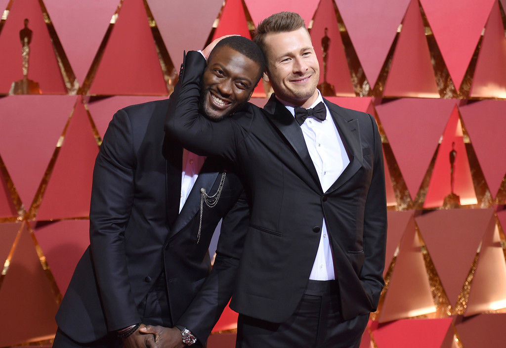 . Aldis Hodge, left, and Glen Powell arrive at the Oscars on Sunday, Feb. 26, 2017, at the Dolby Theatre in Los Angeles. (Photo by Richard Shotwell/Invision/AP)
