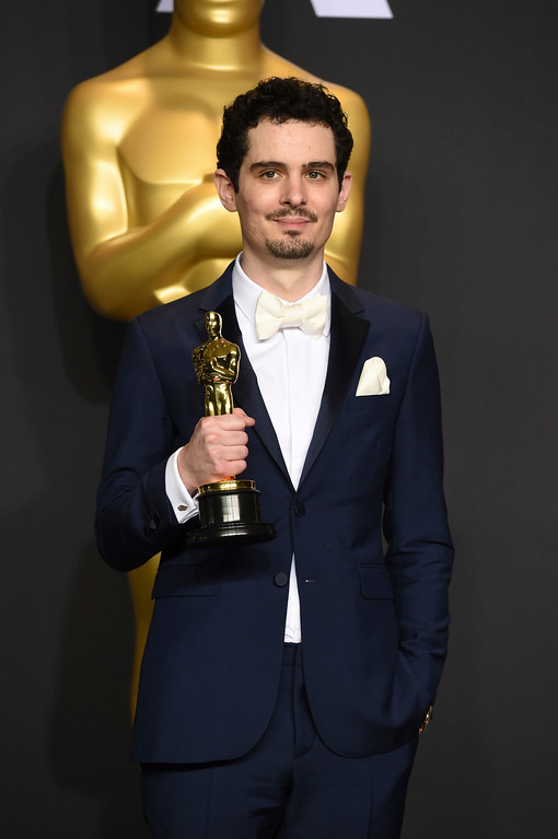 """. Damien Chazelle poses in the press room with the award for best director for \""""La La Land\"""" at the Oscars on Sunday, Feb. 26, 2017, at the Dolby Theatre in Los Angeles. (Photo by Jordan Strauss/Invision/AP)"""