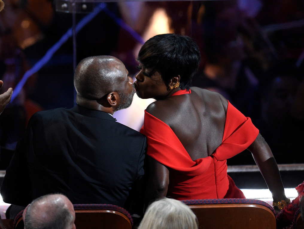 """. Viola Davis, winner of the award for best actress in a supporting role for \""""Fences,\"""" right, and Julius Tennon kiss at the Oscars on Sunday, Feb. 26, 2017, at the Dolby Theatre in Los Angeles. (Photo by Chris Pizzello/Invision/AP)"""