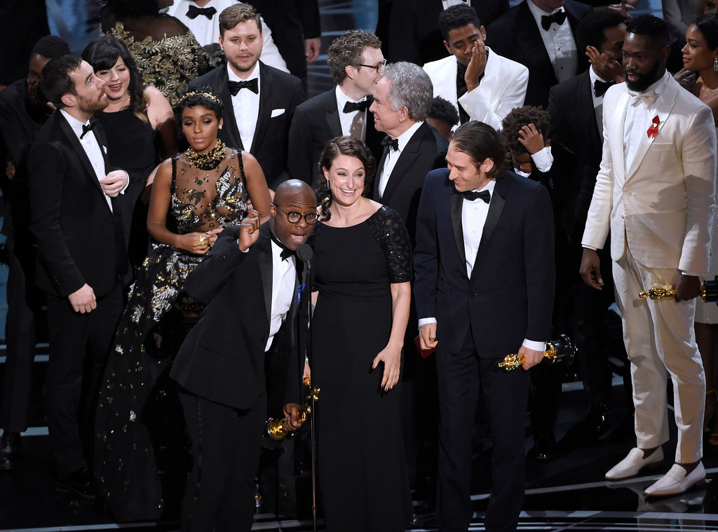 """. Barry Jenkins, foreground left, and the cast accept the award for best picture for \""""Moonlight\"""" at the Oscars on Sunday, Feb. 26, 2017, at the Dolby Theatre in Los Angeles. (Photo by Chris Pizzello/Invision/AP)"""