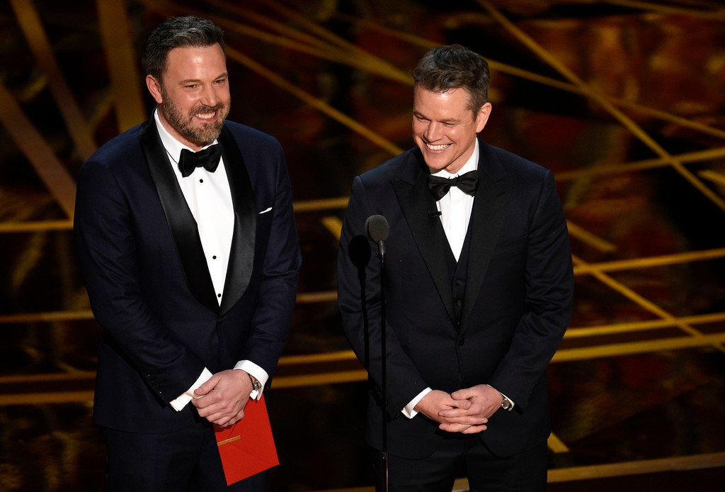 . Ben Affleck, left, and Matt Damon present the award for best original screenplay at the Oscars on Sunday, Feb. 26, 2017, at the Dolby Theatre in Los Angeles. (Photo by Chris Pizzello/Invision/AP)