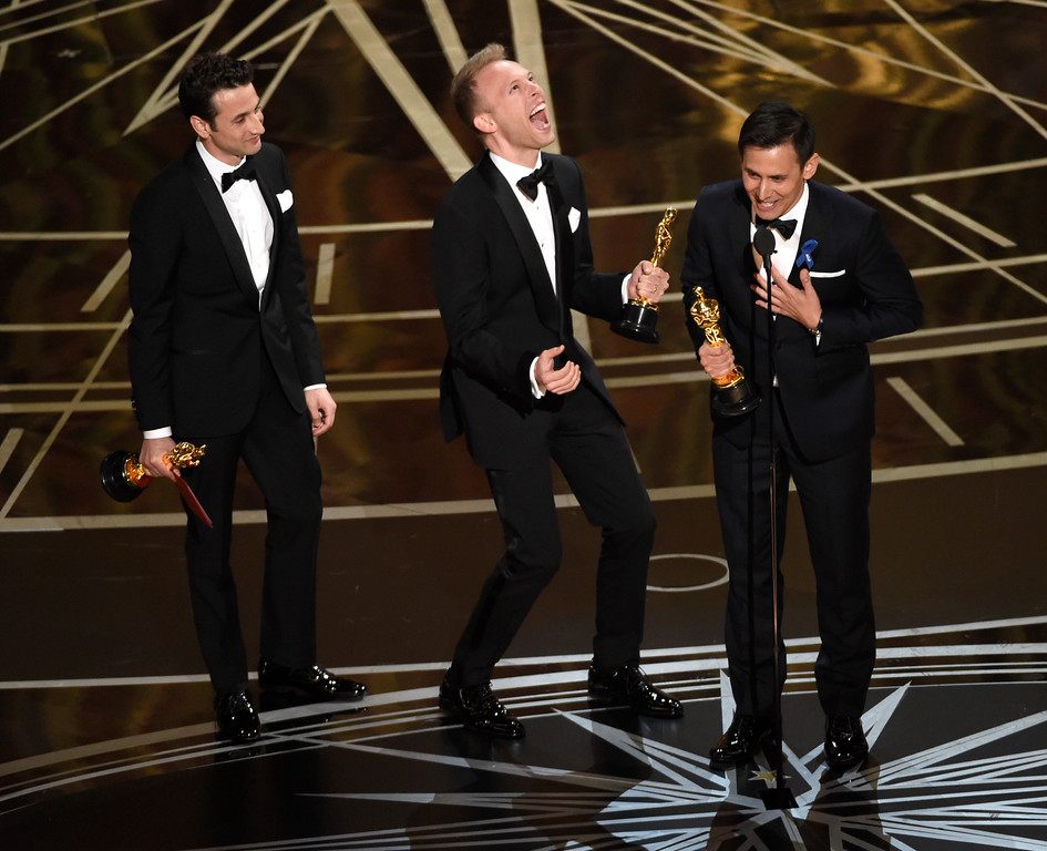 """. Justin Hurwitz, from left, Justin Paul, and Benj Pasek accept the award for best original song for \""""City of Stars\"""" from \""""La La Land\"""" at the Oscars on Sunday, Feb. 26, 2017, at the Dolby Theatre in Los Angeles. (Photo by Chris Pizzello/Invision/AP)"""
