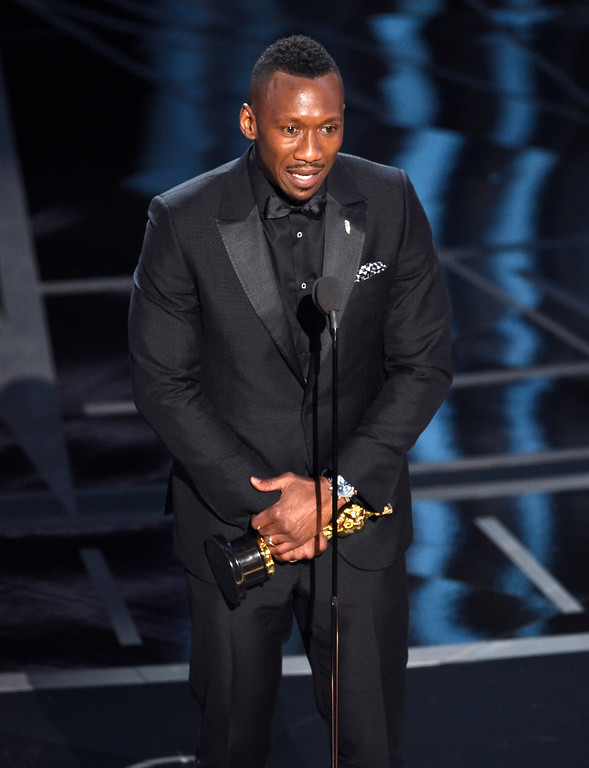 """. Mahershala Ali accepts the award for best actor in a supporting role for \""""Moonlight\"""" at the Oscars on Sunday, Feb. 26, 2017, at the Dolby Theatre in Los Angeles. (Photo by Chris Pizzello/Invision/AP)"""