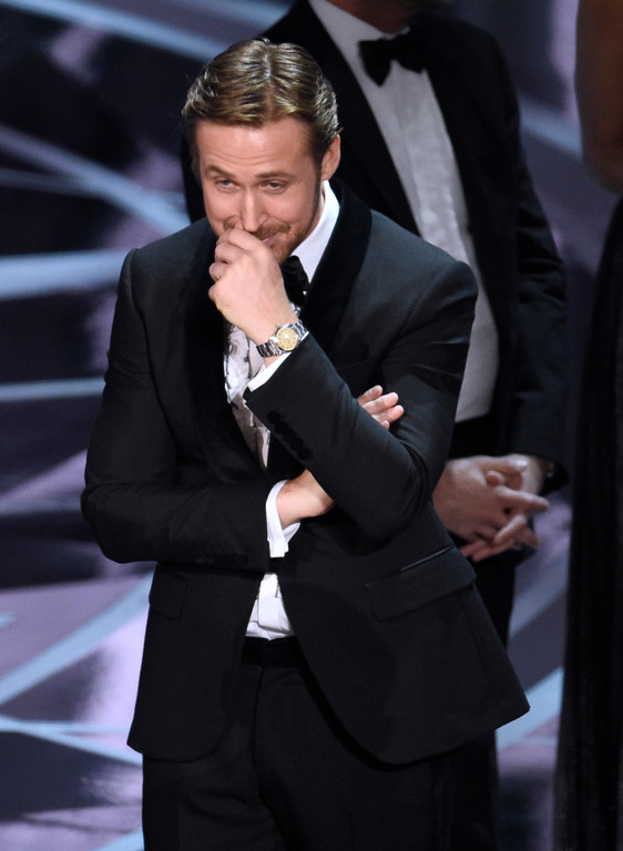 """. Ryan Gosling reacts as the true winner of best picture is announced at the Oscars on Sunday, Feb. 26, 2017, at the Dolby Theatre in Los Angeles. It was originally announced that \""""La La Land\"""" won, but the winner was actually, \""""Moonlight.\"""" (Photo by Chris Pizzello/Invision/AP)"""