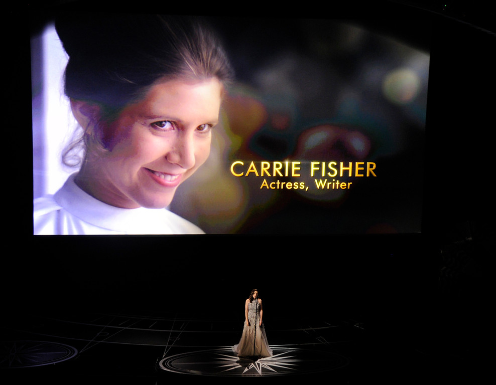 . An image of the late Carrie Fisher is displayed as Sara Bareilles performs during the In Memoriam tribute at the Oscars on Sunday, Feb. 26, 2017, at the Dolby Theatre in Los Angeles. Carrie Fisher is pictured on screen. (Photo by Chris Pizzello/Invision/AP)