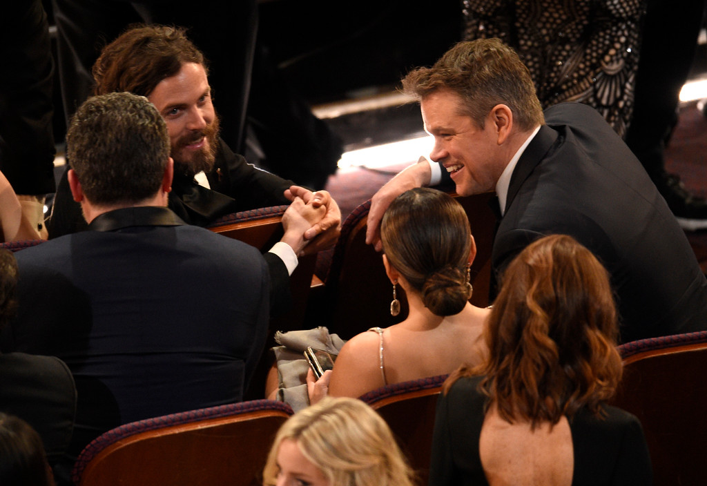 . Ben Affleck, from left, Casey Affleck and Matt Damon appear in the audience at the Oscars on Sunday, Feb. 26, 2017, at the Dolby Theatre in Los Angeles. (Photo by Chris Pizzello/Invision/AP)