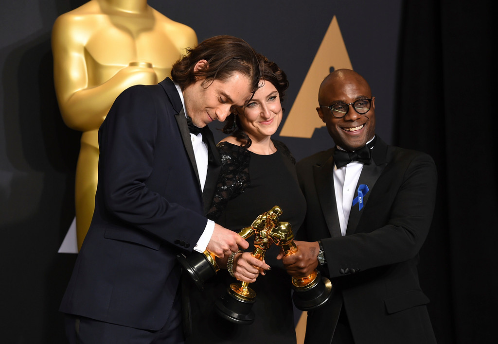 """. Jeremy Kleiner, from left, Adele Romanski and Barry Jenkins, winners of the award for best picture for \""""Moonlight\"""", pose in the press room at the Oscars on Sunday, Feb. 26, 2017, at the Dolby Theatre in Los Angeles. (Photo by Jordan Strauss/Invision/AP)"""