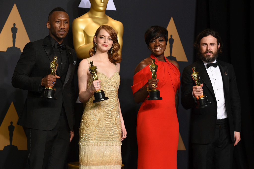 """. Mahershala Ali, winner of the award for best actor in a supporting role for \""""Moonlight\"""", from left, Emma Stone, winner of the award for best actress in a leading role for \""""La La Land\"""", Viola Davis, winner of the award for best actress in a supporting role for \""""Fences\"""", and Casey Affleck, winner of the award for best actor in a leading role for \""""Manchester by the Sea\"""", pose in the press room at the Oscars on Sunday, Feb. 26, 2017, at the Dolby Theatre in Los Angeles. (Photo by Jordan Strauss/Invision/AP)"""