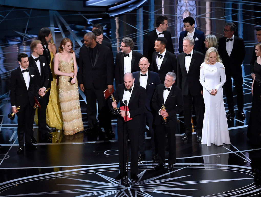 """. Jordan Horowitz, foreground center, and the cast of \""""La La Land\"""" mistakenly accept the award for best picture at the Oscars on Sunday, Feb. 26, 2017, at the Dolby Theatre in Los Angeles. It was later announced that \""""Moonlight,\"""" was the winner for best picture. (Photo by Chris Pizzello/Invision/AP)"""