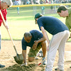 STAN HUDY - SHUDY@DIGITALFIRSTMEDIA.COM<br /> Saratoga Springs Little League do some yard work at second base to secure the bag during the Adirondack Cup minors championship game.