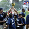 STAN HUDY - SHUDY@DIGITALFIRSTMEDIA.COM<br /> Saratoga Little League minor champions Julie & Co. Realty reach up for a chance to touch the Adirondack Cup after defeating Glens Falls minors champs Hudson River Community Credit Union Saturday night at West Side Recreatioanl Fields.