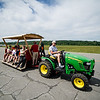 A tractor carrying Young Eagles and other guests gives a tour of the runway during the Fitchburg Airport Aero Fair hosted by the Fitchburg Pilots Association at the Fitchburg Municipal Airport on Sunday June 11, 2017.  SENTINEL & ENTERPRISE/JEFF PORTER