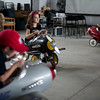 Left to right; Charles Kuper, 6, of Sudbury, Brianna Gray, 11, of Clinton, and Shyla Gray, 7, also of Clinton, wheel around inside metal airplane carts during the Fitchburg Airport Aero Fair hosted by the Fitchburg Pilots Association at the Fitchburg Municipal Airport on Sunday June 11, 2017.  SENTINEL & ENTERPRISE/JEFF PORTER
