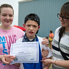 Pictured center is newly certified Young Eagle 14 year old, Jaime Beloin, with Norlani Beloin (left) and Natalie Beloin (right), of Fitchburg, during the Fitchburg Airport Aero Fair hosted by the Fitchburg Pilots Association at the Fitchburg Municipal Airport on Sunday June 11, 2017.  SENTINEL & ENTERPRISE/JEFF PORTER