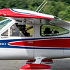 Pilot's bus a plane with a kid from the Young Eagles program which awards flying time for future pilots during the Fitchburg Airport Aero Fair hosted by the Fitchburg Pilots Association at the Fitchburg Municipal Airport on Sunday June 11, 2017.  SENTINEL & ENTERPRISE/JEFF PORTER