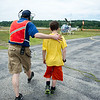 Bill Gruber (left) walks 11 year old Jacen Smakal of Lunenburg toward the helicopter during the Fitchburg Airport Aero Fair hosted by the Fitchburg Pilots Association at the Fitchburg Municipal Airport on Sunday June 11, 2017.  SENTINEL & ENTERPRISE/JEFF PORTER
