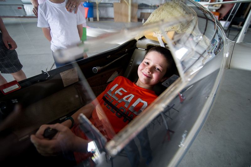 Mitchell Poladian, 9, of Fitchburg, manages the controls inside a glider on display inside the airports newest hanger during the Fitchburg Airport Aero Fair hosted by the Fitchburg Pilots Association at the Fitchburg Municipal Airport on Sunday June 11, 2017.  SENTINEL & ENTERPRISE/JEFF PORTER