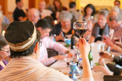 IMG_8099 Rabbi Ilene Haigh holds up wine at start of service