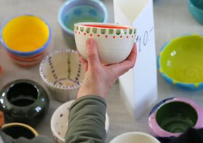 IMG_7029 someone picking a bowl