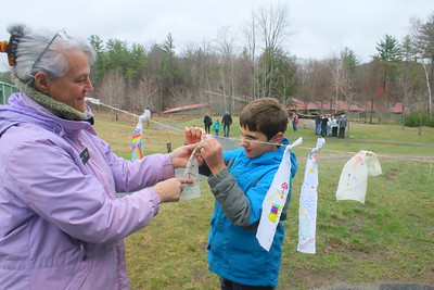 IMG_9319 volunteer Zooey Zullo helps caleb St  Peter hang a prayer flag,,from Barre