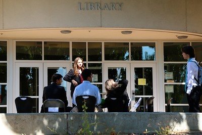 Whitney High School seniors wait outside the library for their scheduled mock job interview.