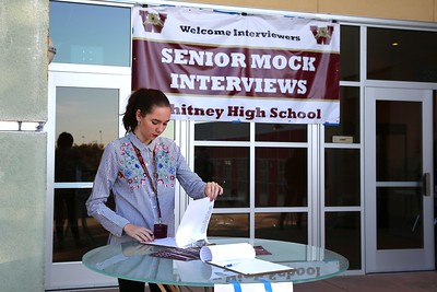 Student volunteer Samantha Olson prepares to check in guest interviewers