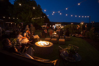 Sitting around a campfire on a comfy chair, glass of wine in hand, and live music? Does glamping get better than this??? Photo ©2017 by Jason Tinacci / Napa Valley Vintners
