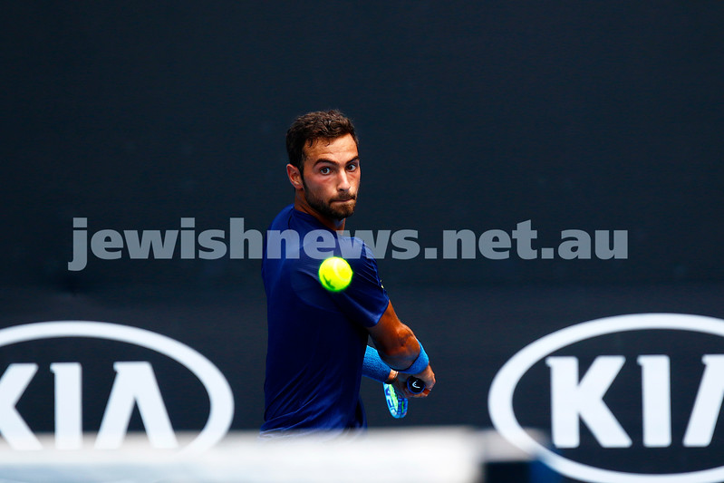 11-1-17. American Noah Rubin overcame a bit of a shakey start to defeat Germany's Cedrik-Marcel Stebe in three sets, 5-7 6-4 6-4 and advance to the next round of qualifying for the main draw of the Australian Open. Photo: peter Haskin