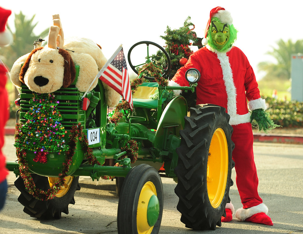 . BENICIA, CA- DEC. 9, Paul Bismuke, dressed as The Grinch, waits to ride with the Benicia Tractor Club in the holiday parade on Saturday. (CHRIS RILEY/Times-Herald)