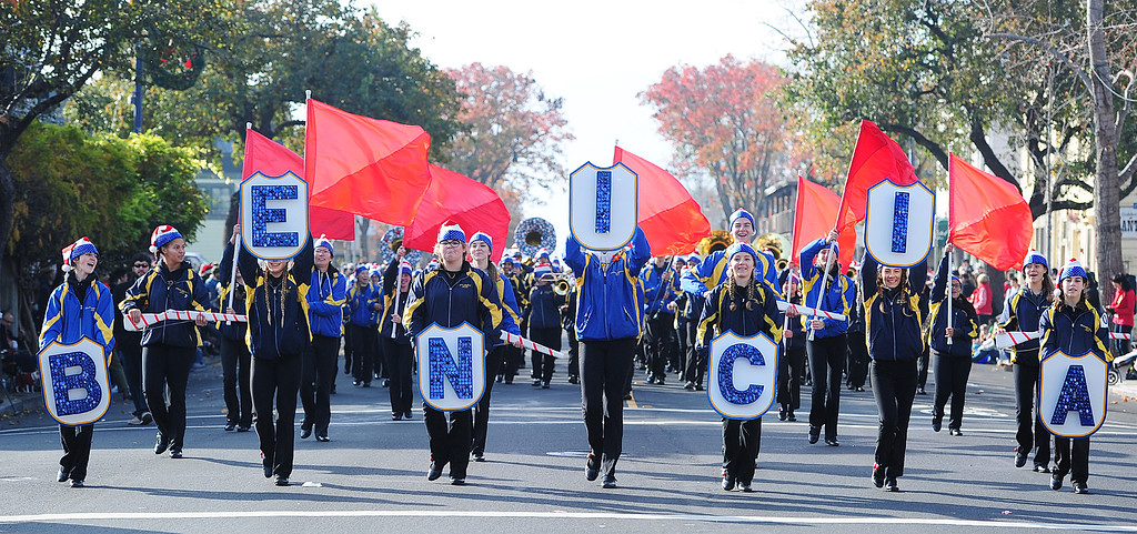 . BENICIA, CA- DEC. 9, The Benicia High School Marching band amke their way through downtown during the Benicia Holiday Parade down First Street on Saturday. (CHRIS RILEY/Times-Herald)
