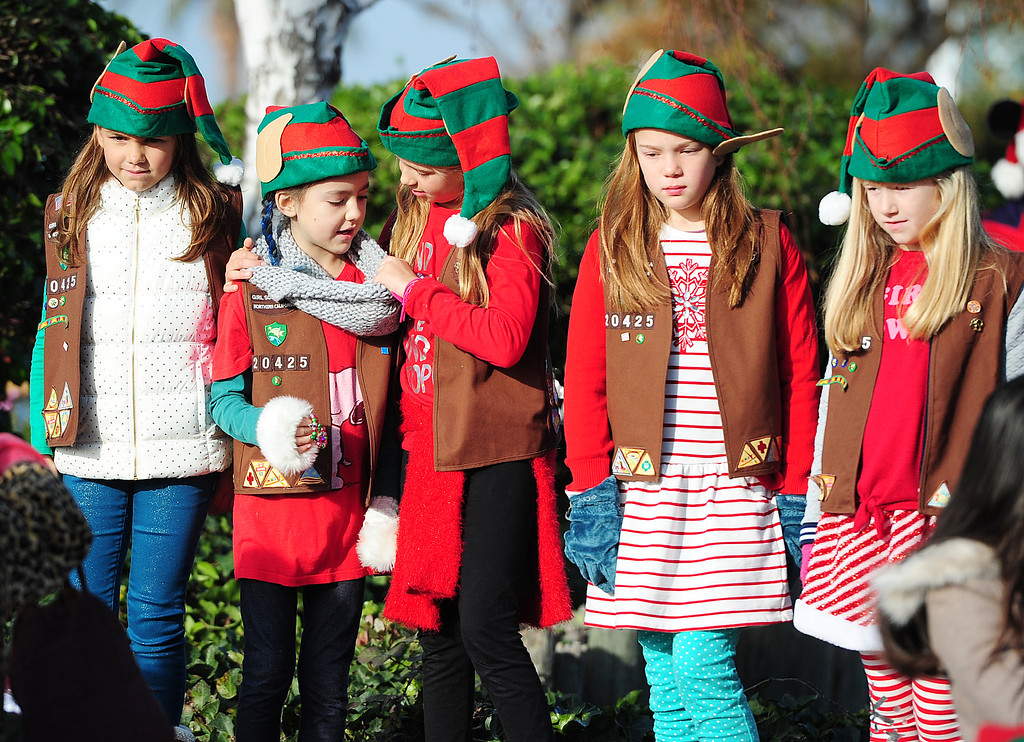 . BENICIA, CA- DEC. 9, Girls Scouts with Troop 20425 wait before the start of the Benicia Holiday Parade down First Street on Saturday. (CHRIS RILEY/Times-Herald)