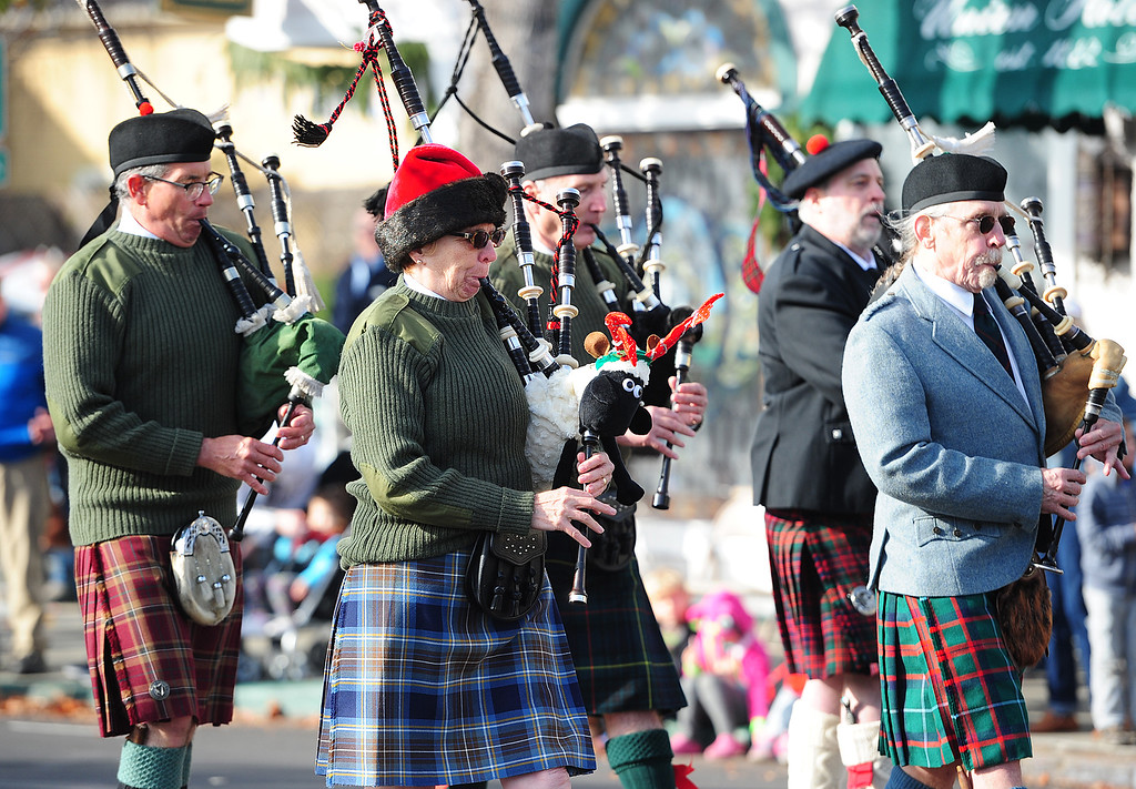 . BENICIA, CA- DEC. 9,A group plays bagpipes as they walk through downtown during the Benicia Holiday Parade down First Street on Saturday. (CHRIS RILEY/Times-Herald)