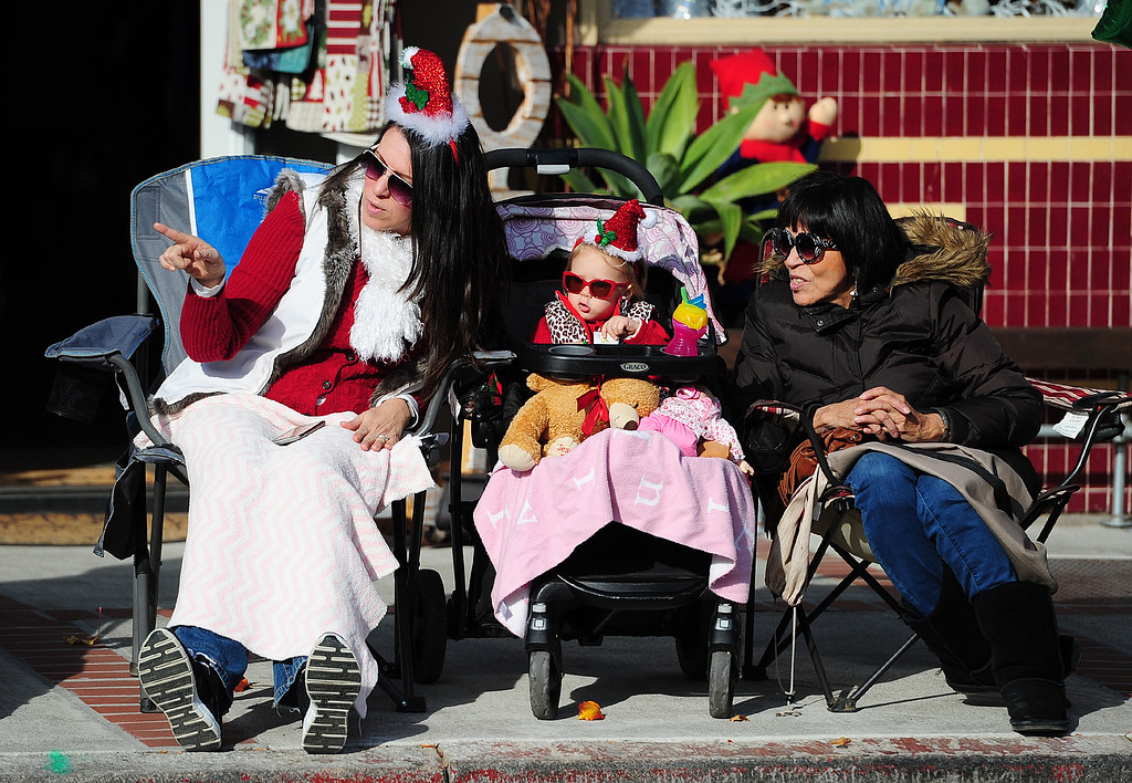 . BENICIA, CA- DEC. 9, Spectators watch as the Benicia Holiday Parade passes down First Street on Saturday. (CHRIS RILEY/Times-Herald)
